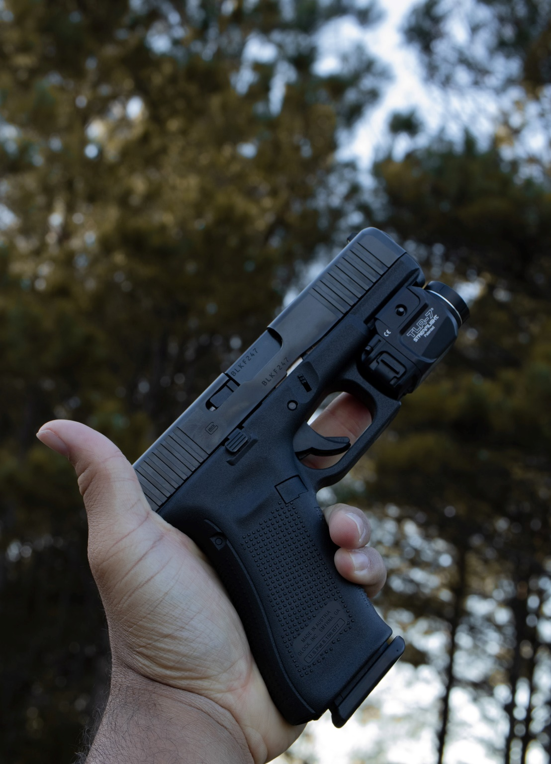Holding a pistol