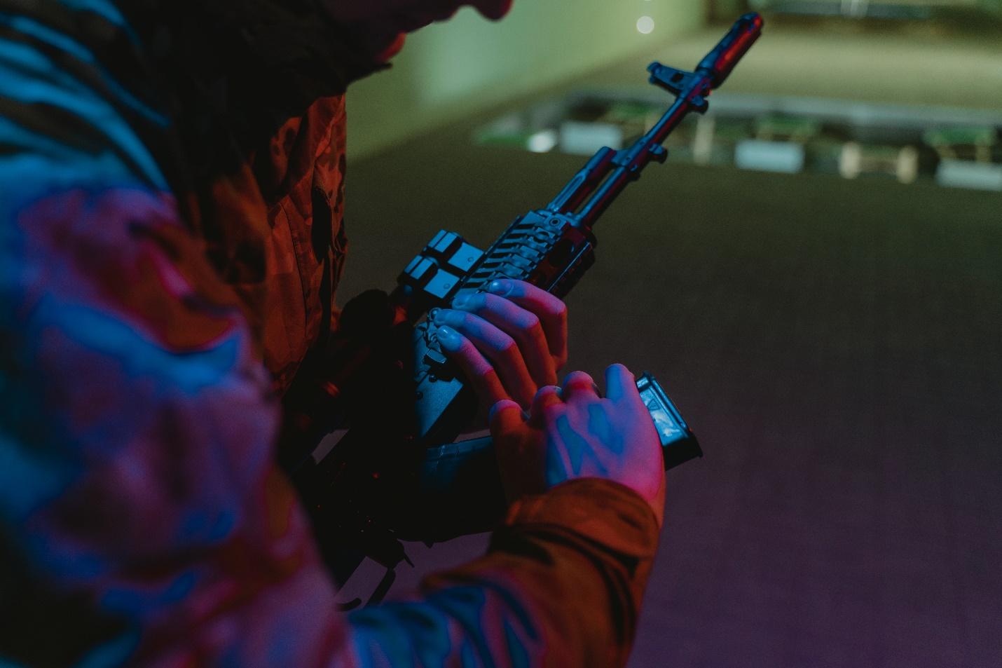 Man holding a gun at a shooting range