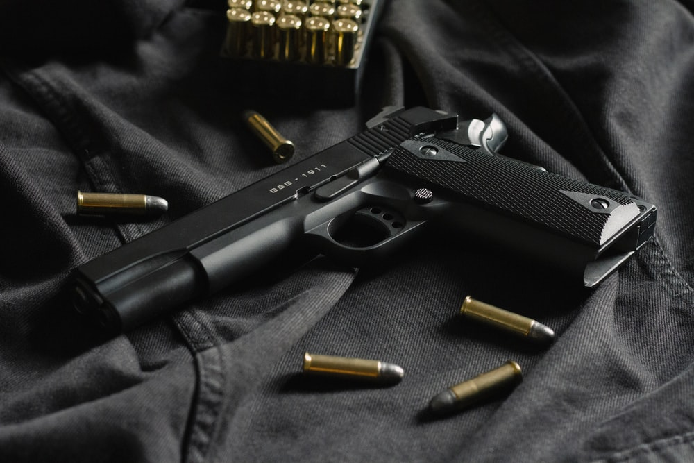 gun and bullters on a jacket
