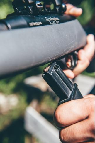 a man using black rifle in a shooting range in Laramie