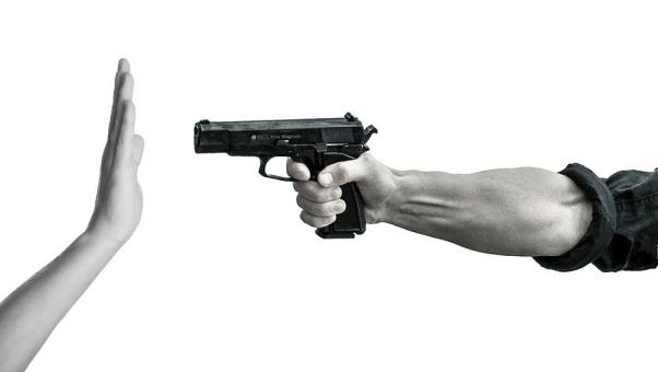 A person irresponsibly pointing a gun at another individual